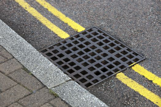 Street drain over Double yellow line on street