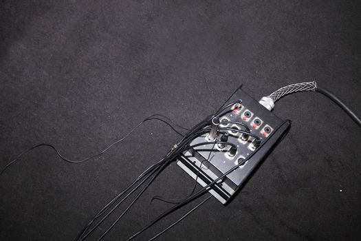 Wires attached to electric box in television studio