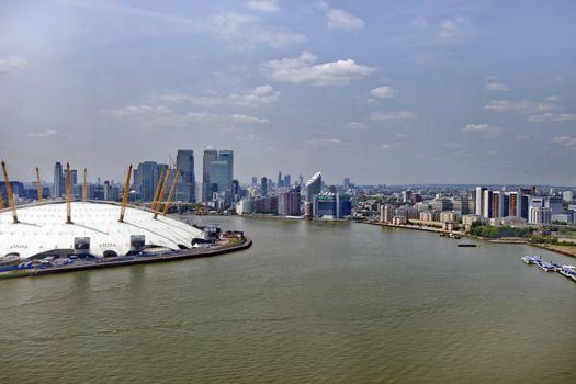 UK, England, London, 02 Arena and Canary Wharf Skyline