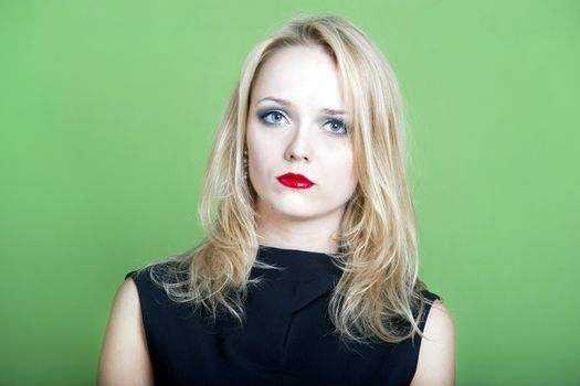 Blonde woman on green background