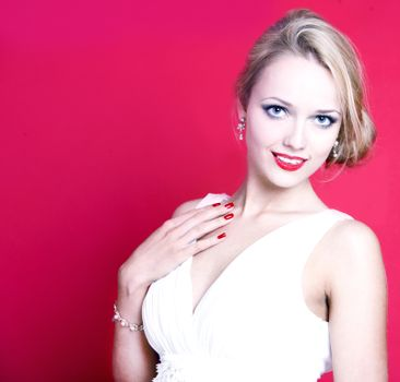 Caucasian woman wearing white dress on red background