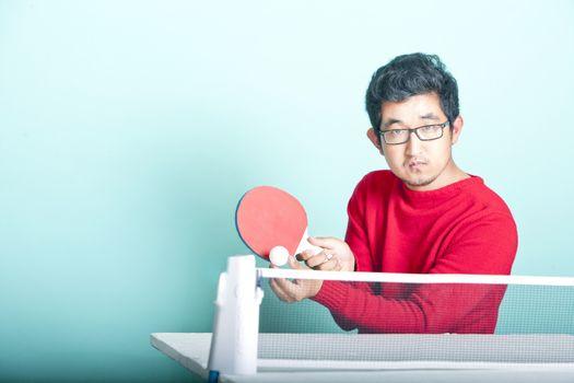 Asian man playing table tennis