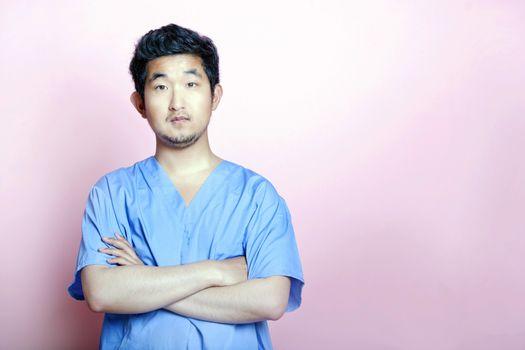 Young Asian Trainee Doctor wearing Scrubs