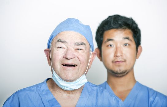 A portrait of Senior adult surgeon and a young Asian doctor