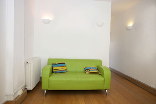 Cushions on green sofa in empty office