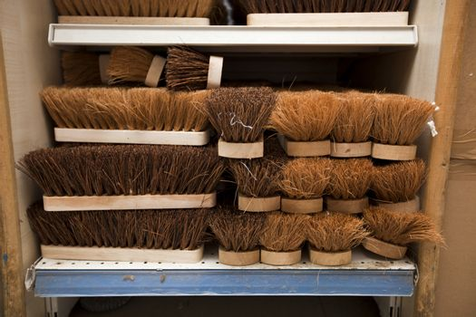 Stacked brushes in supermarket