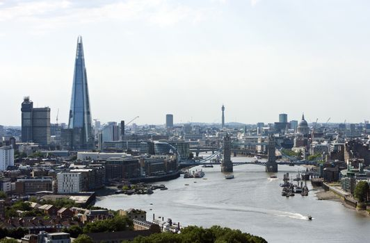 Elevated view of Tower Bridge, The Shard, and St Pauls in London