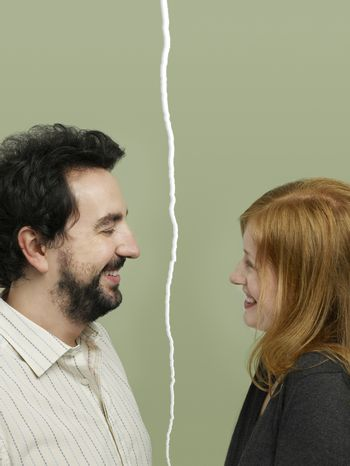 Side view of mid-adult couple facing relationship difficulties