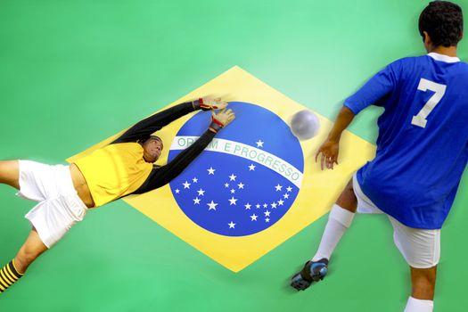 Soccer player scoring goal in front of Brazilian Flag