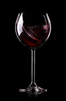 Wave of wine in wineglass