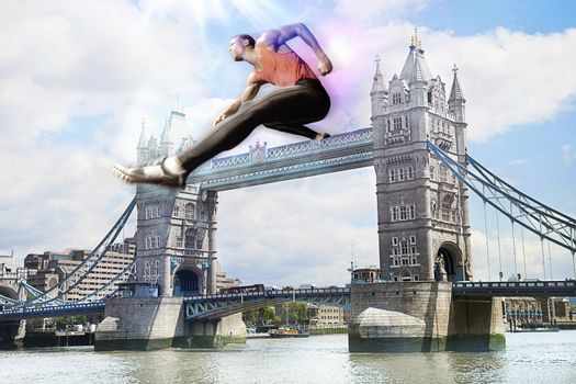 Male Athlete hurdling Tower Bridge