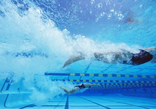 Young Caucasian female swimmers swimming in pool