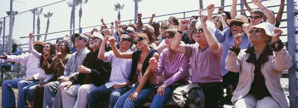 Panoramic shot of crowd cheering in stadium