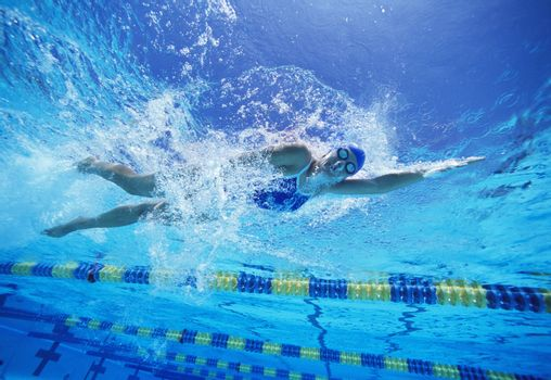 Female swimmer in United States swimsuit while swimming in pool