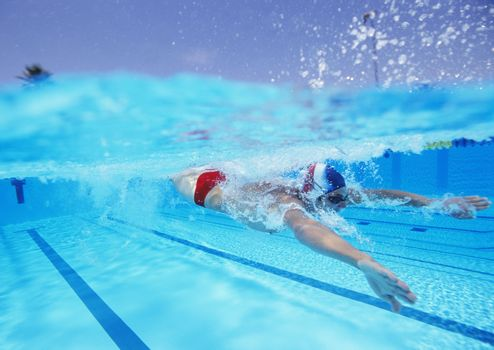 Professional male athlete swimming in pool