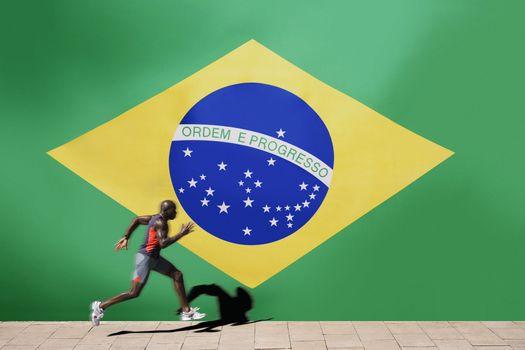 Athlete running past Brazilian flag