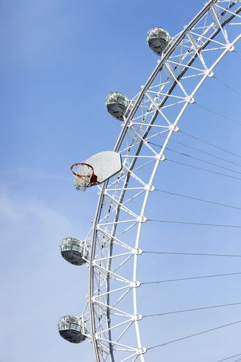 Large Ferris Wheel with a large basketball board and hoop attached