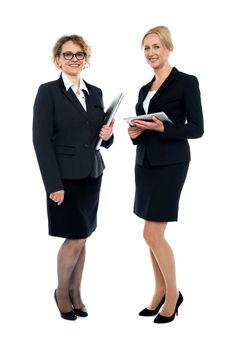 Experienced corporate ladies interacting