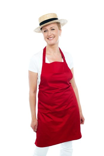 Attractive female chef wearing red apron and hat
