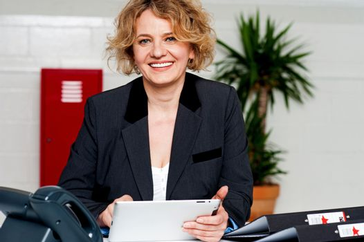 Businesswoman working on touch pad device