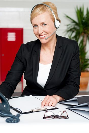 Female assistant communicating with client