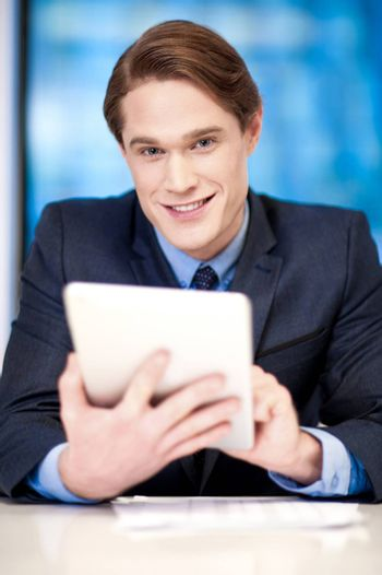 Corporate guy browsing on tablet pc