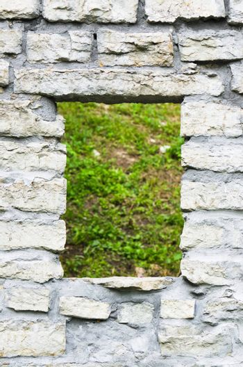 Window aperture in a wall from calcareous stones, a close up