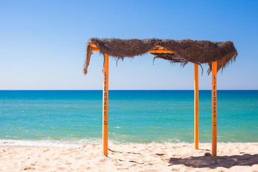 Small canopy at empty tropical beach on the Atlantic coast