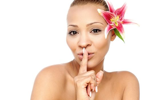 Hush, silence please! Woman gesturing.