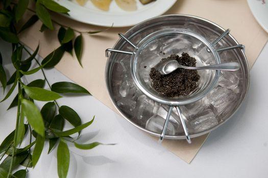 black caviar on the plate