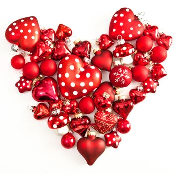 Red christmas ornaments in heart-shape