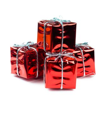 Closeup view of vibrant red christmas decorations in gift boxes shape