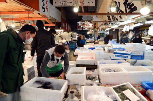 TOKYO - NOV 26: Seafood vendors at the Tsukiji Wholesale Seafood market
