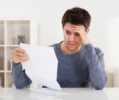 Horrified man reading a document