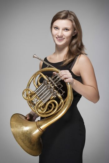 woman musician with french horn
