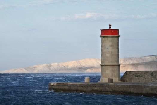 Picture represents the lighthouse while blowing strong wind
