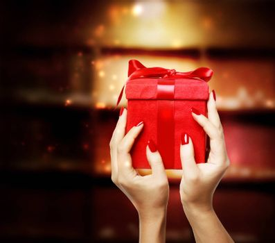 Woman Displaying Red Gift Box