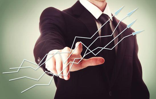 Businessman pointing arrows