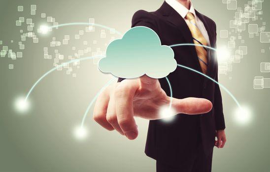 Businessman pushing cloud icon