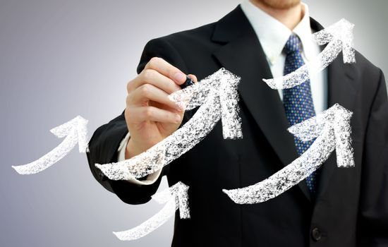 Businessman with Rising Arrows Representing Growth