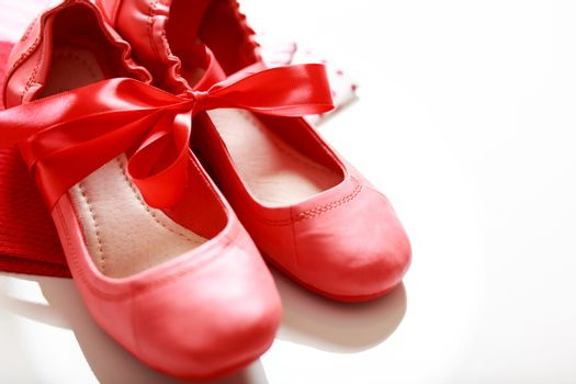 Red shoes with ribbon
