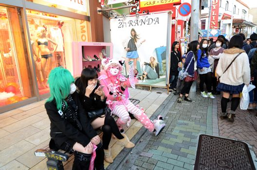 TOKYO - NOV 24 2013: Japanese girls in cosplay outfit gather around Harajuku train station in Tokyo
