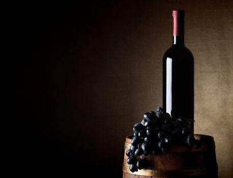 Wine and grape on a barrel