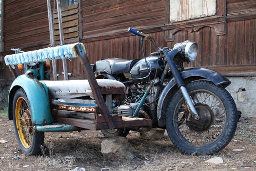 old heavy motorcycle with sidecar
