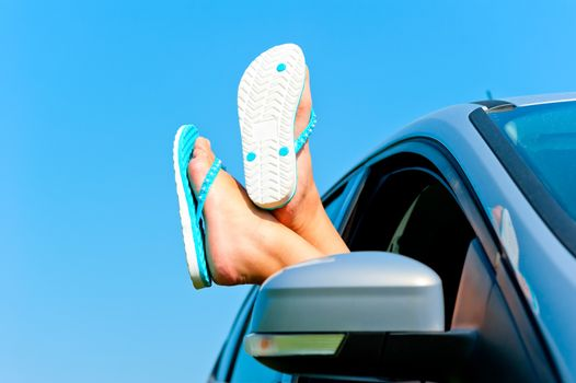 rest in autotravel - female legs in shales in the car