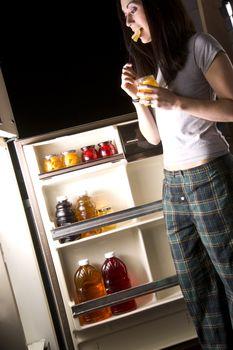 Woman at the Refrigerator Door on late night food binge