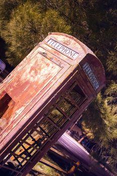 Skewed Vintage Obsolete Outdoor Telephone Booth Southwest Rural