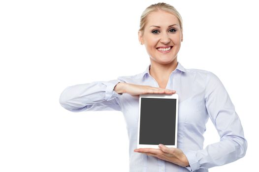 Saleswoman presenting touch pad device