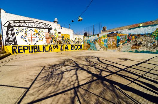 BUENOS AIRES - AUGUST 15: Grafitti in La Boca neighborhood of Buenos Aires on August 15, 2013.  La Boca is one of the main tourist destinations in the city and is also the birthplace of tango