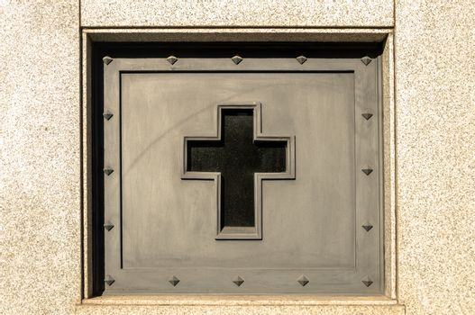Cross decorating a tomb in the Recoleta cemetery in Buenos Aires, Argentina